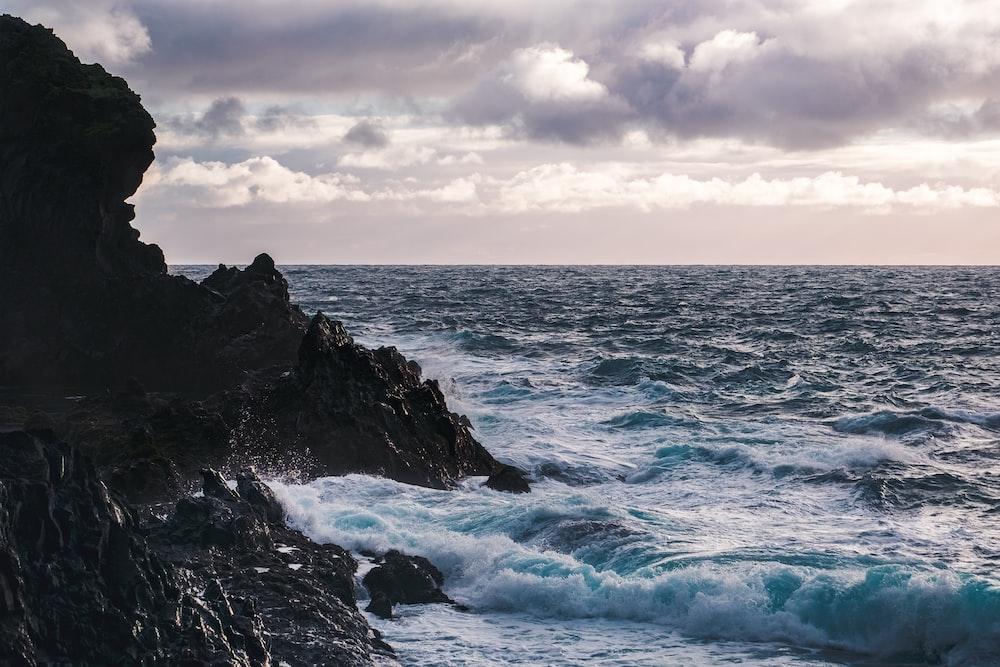rock formation near body of water