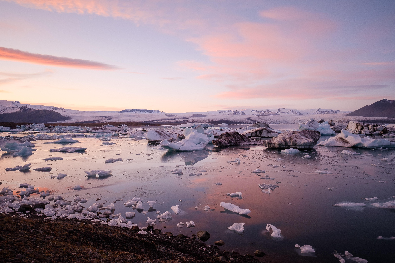 gray stones near ice blocks on river