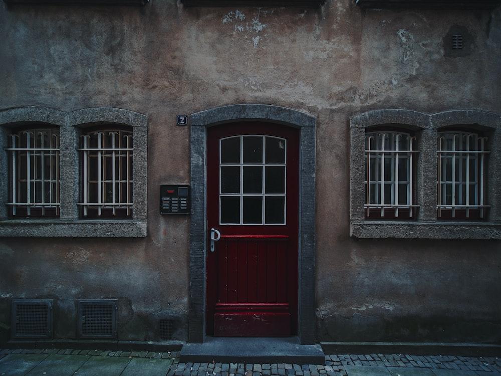 red wooden half-glass closed door