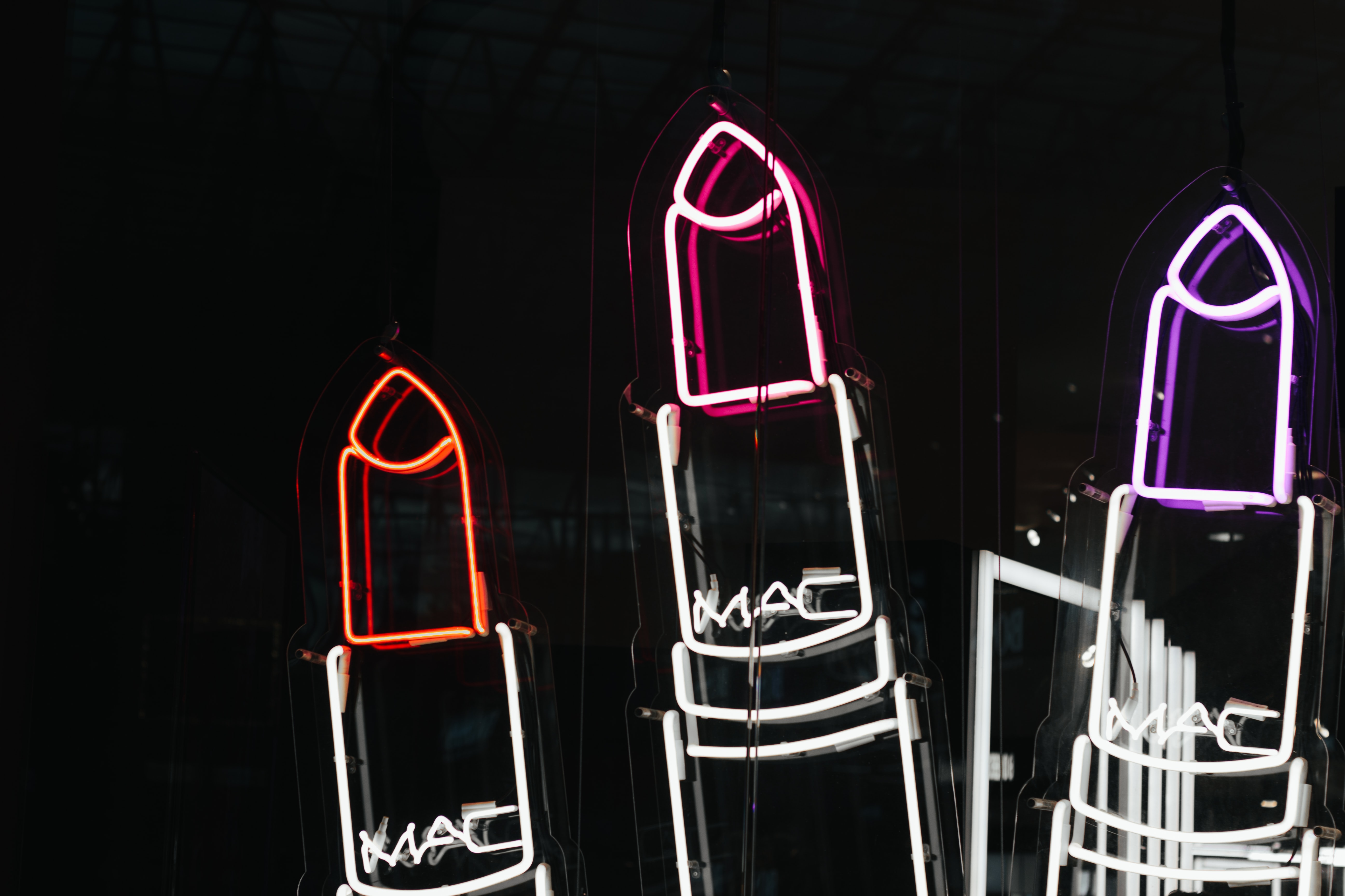 three white MAC lipstick artwork