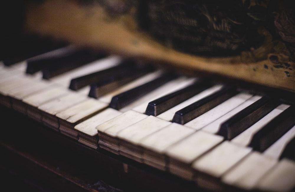 close up photo of white and black piano keys