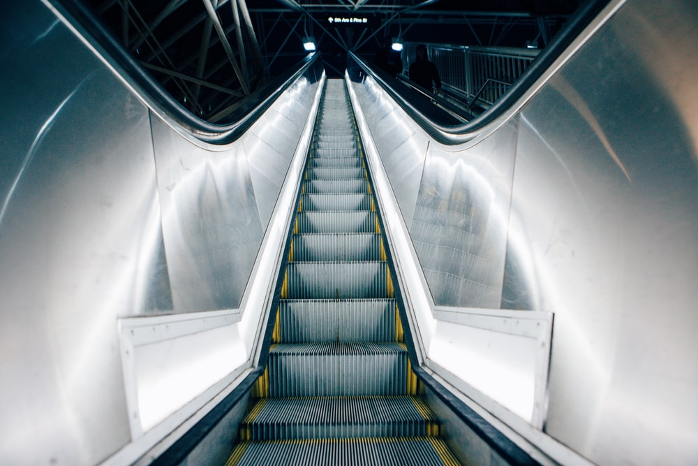 time lapse photo of escalator