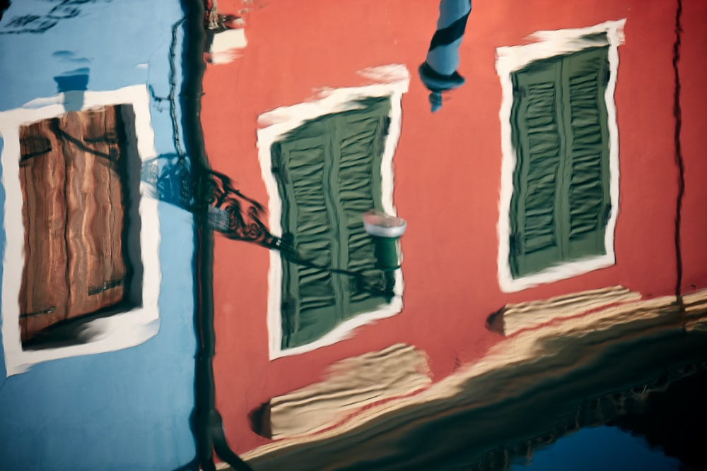painting of red building