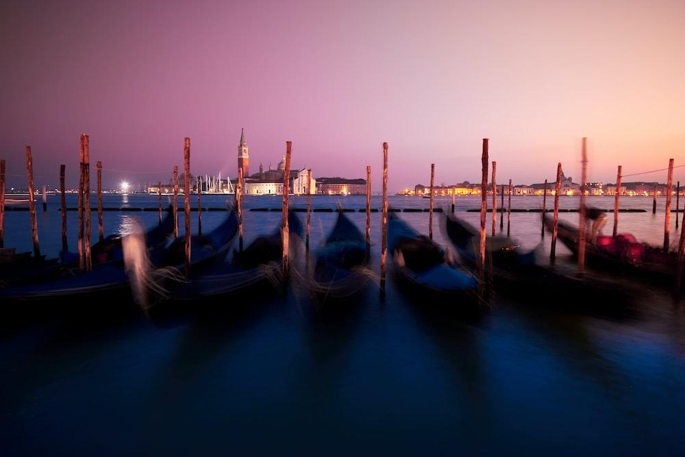 kayaks dock on body of water