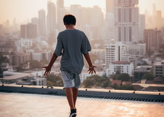 man standing on rooftop