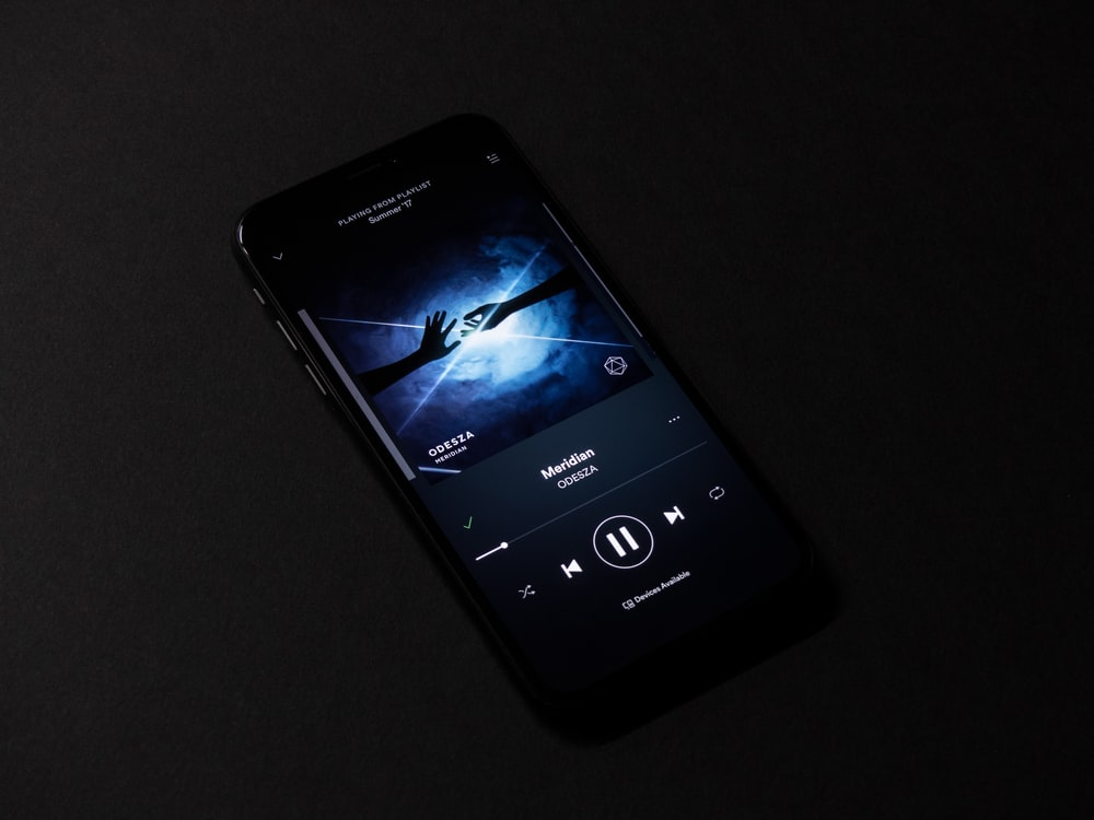 turned-on smartphone with music display