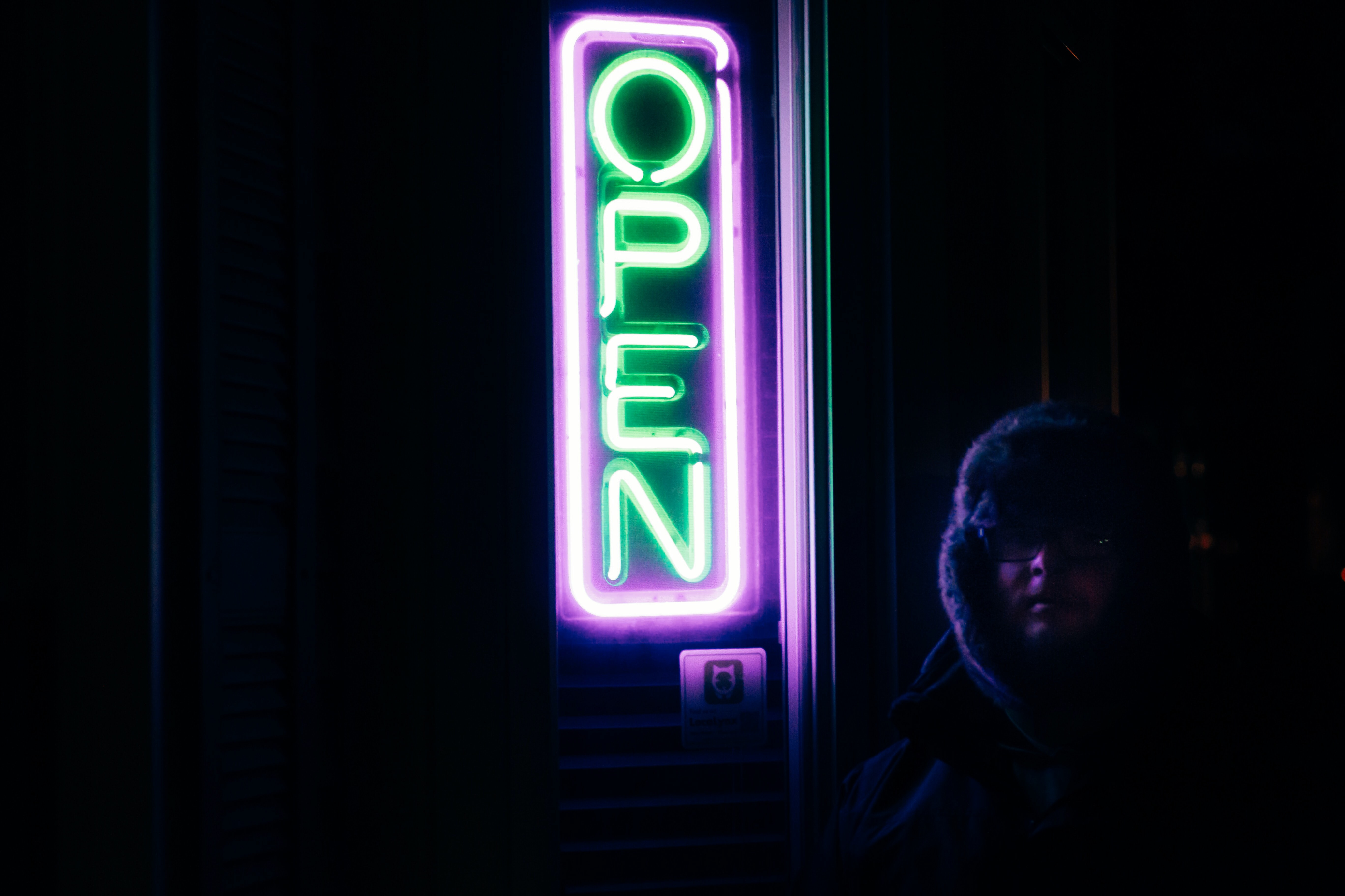 turned on purple and green open neon signage