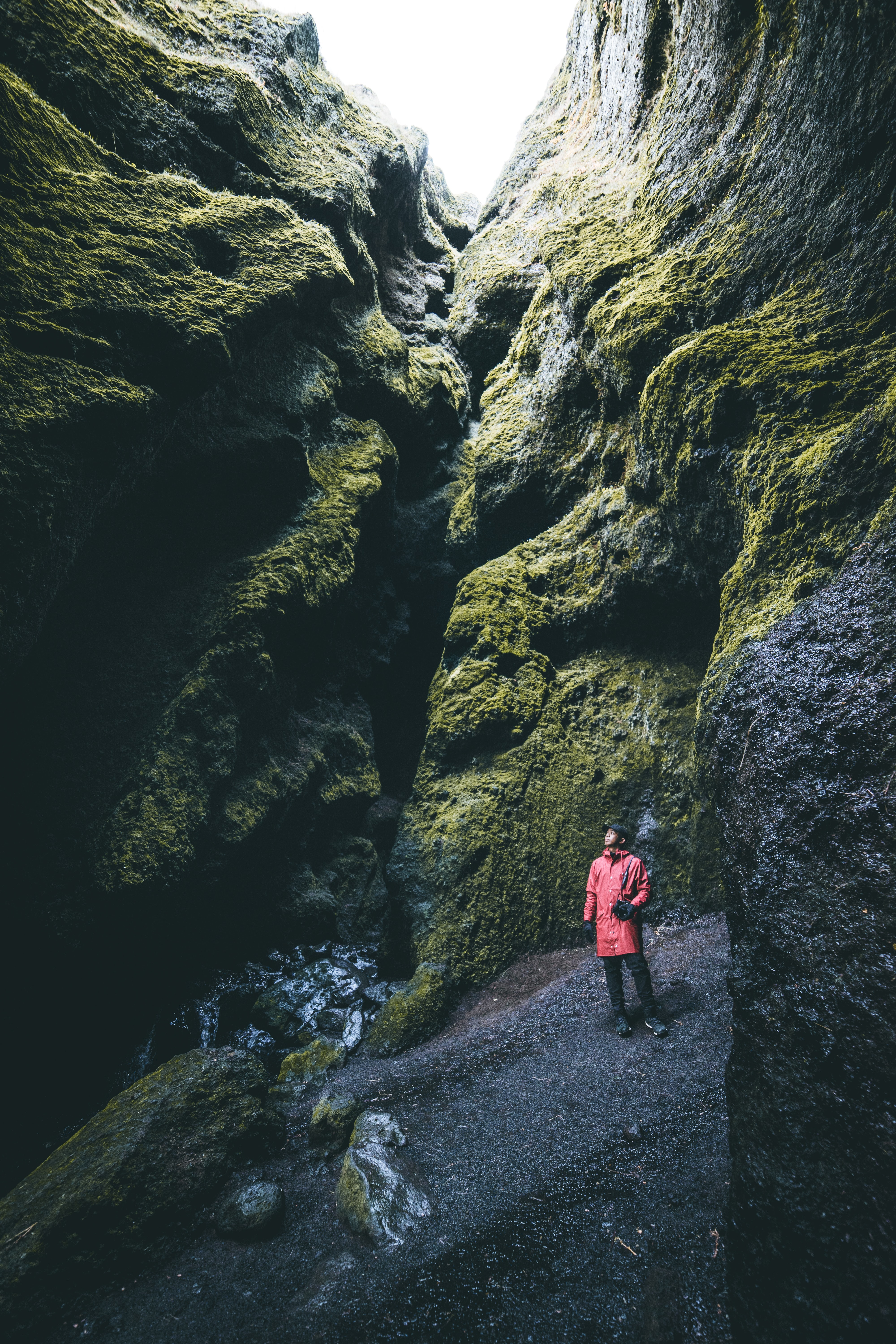 person standing between of hollow cliff