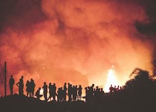people near bonfire during night