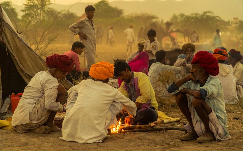 people sitting near bonfire