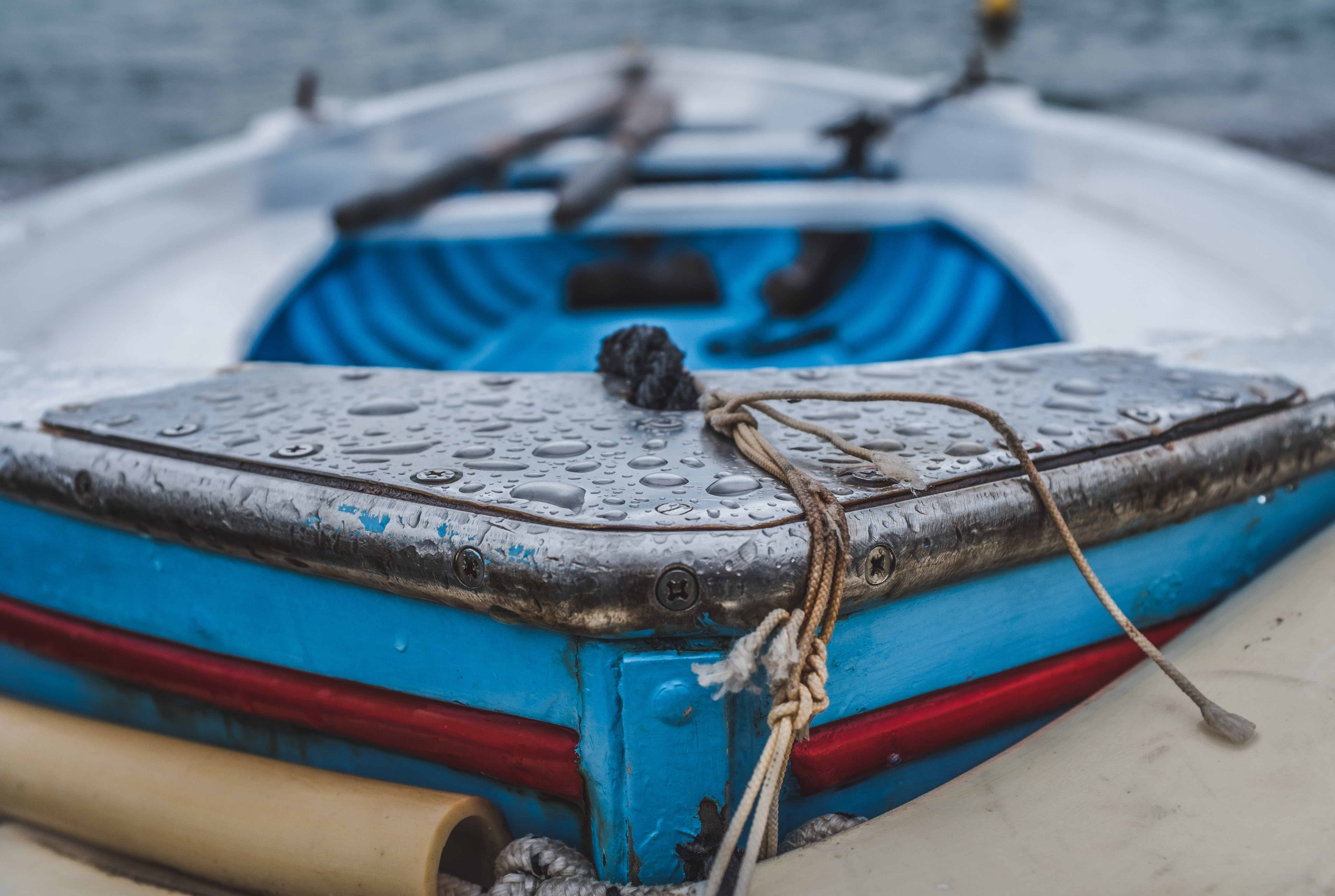 close up photography of boat with water drops