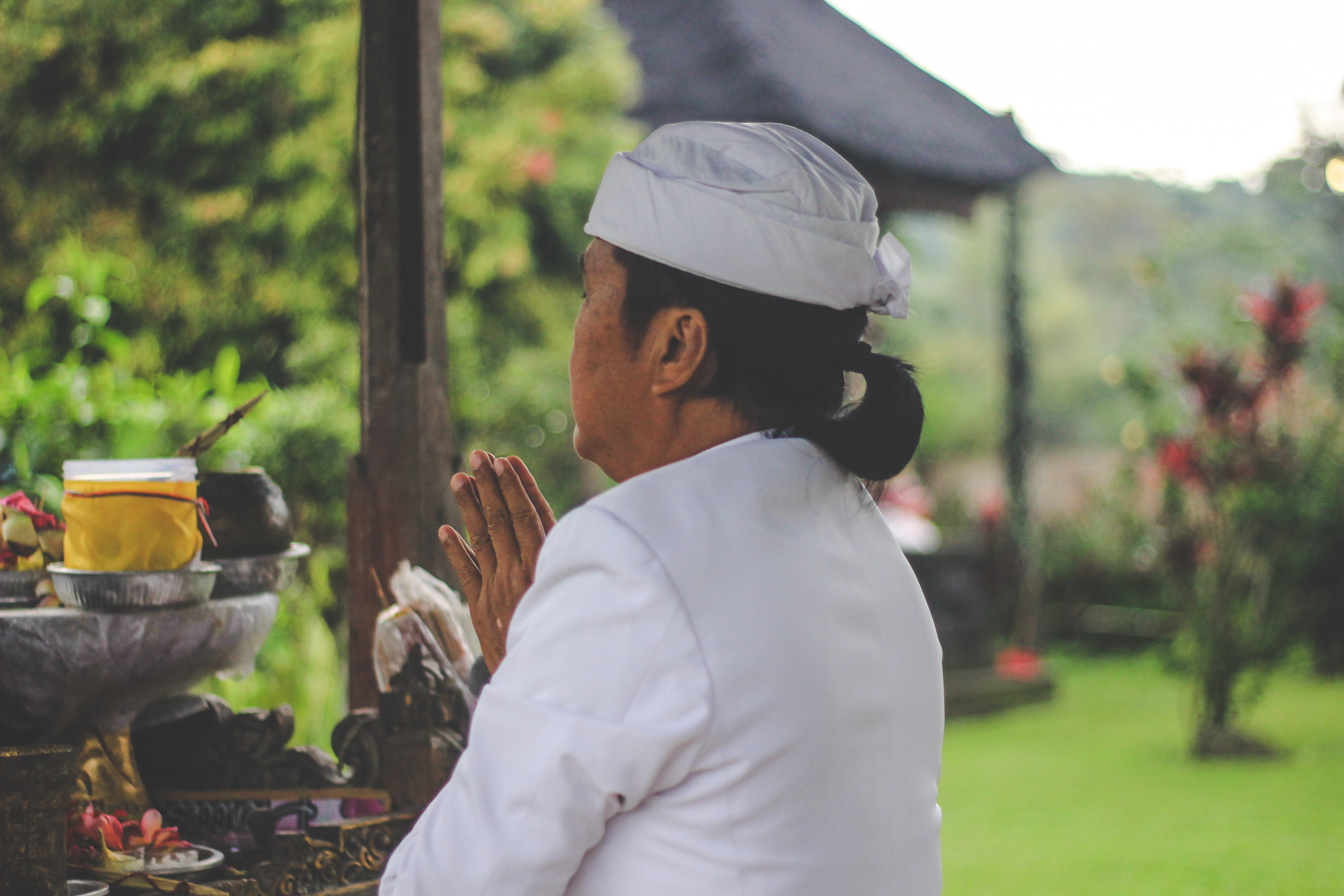person praying in front of table