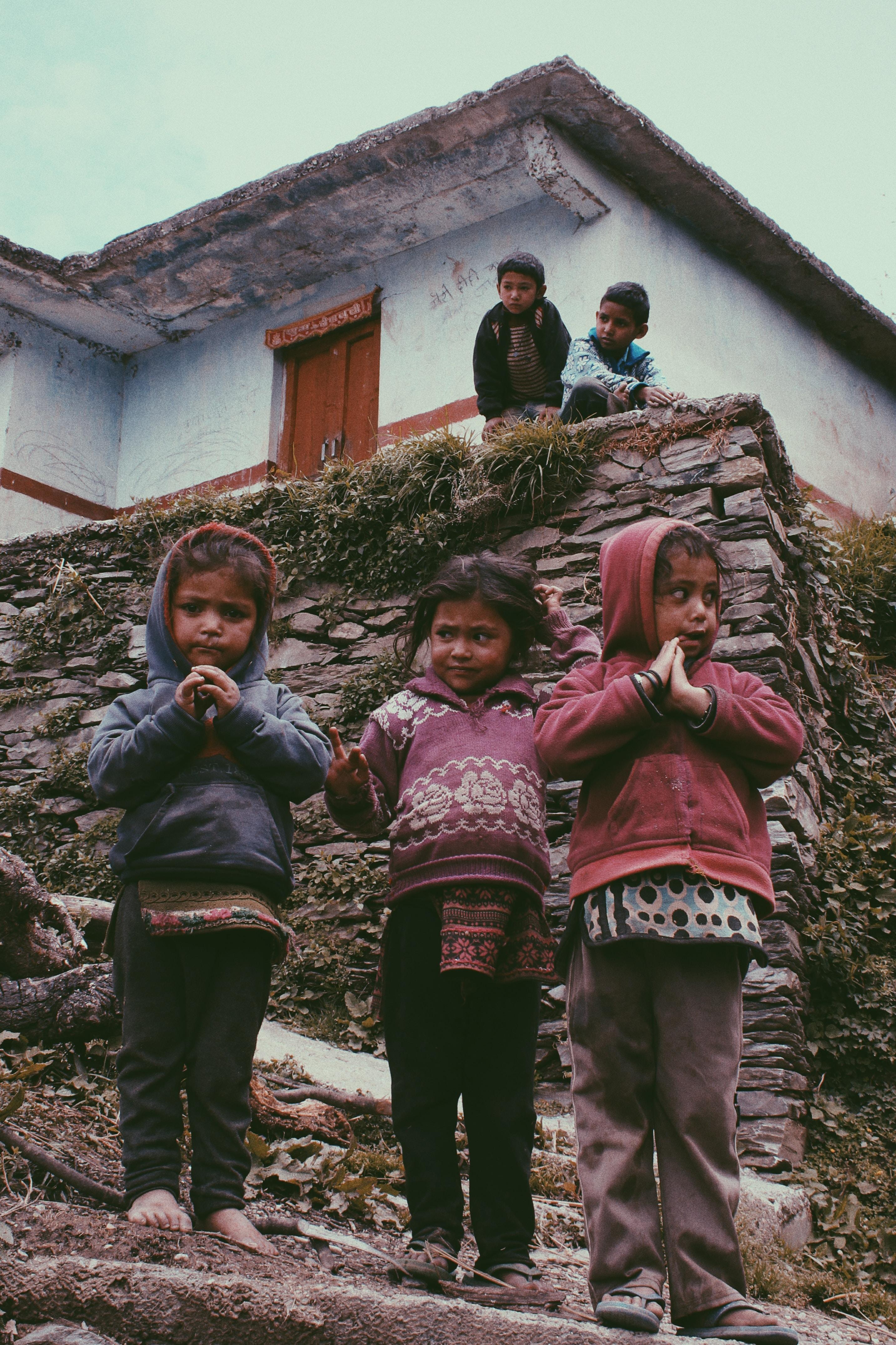 group of children standing near house