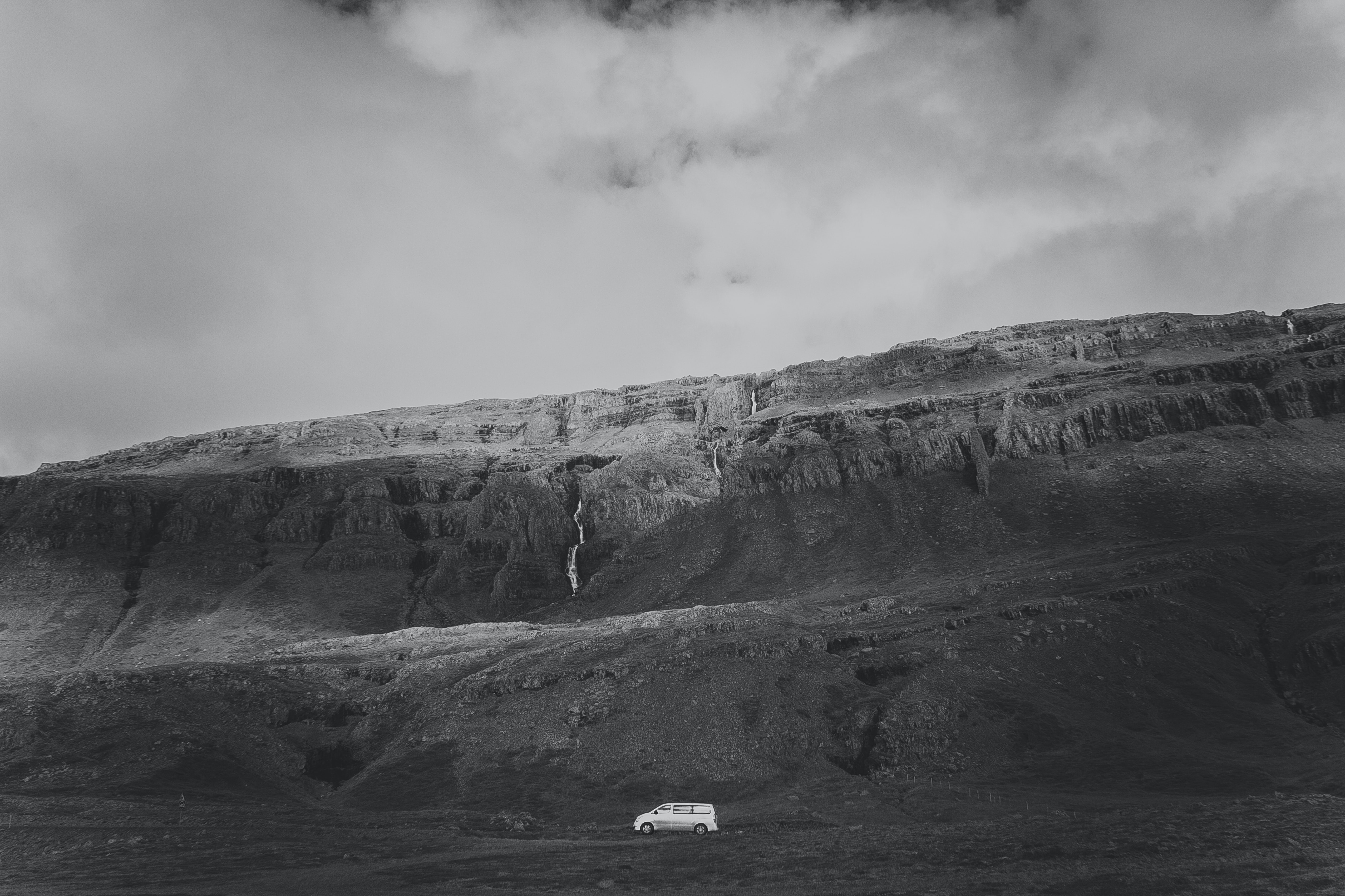 gray mountain in grayscale photography