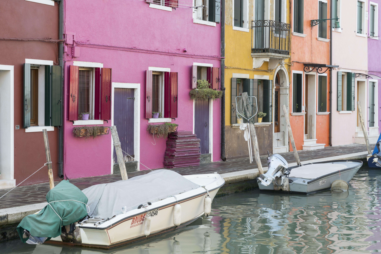 white speedboat parked near house