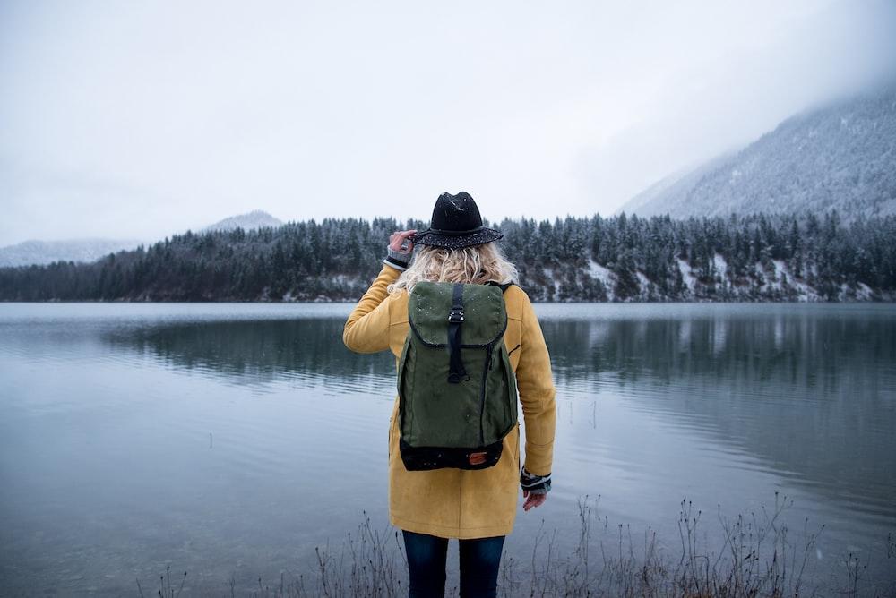 woman standing near body of water