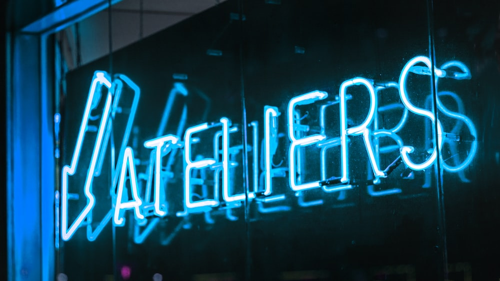 Ateliers neon signage on wall