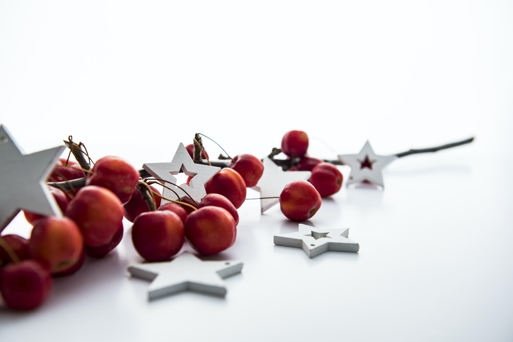 red cherries and white star decorations