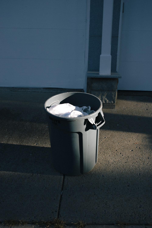 gray plastic trash bin