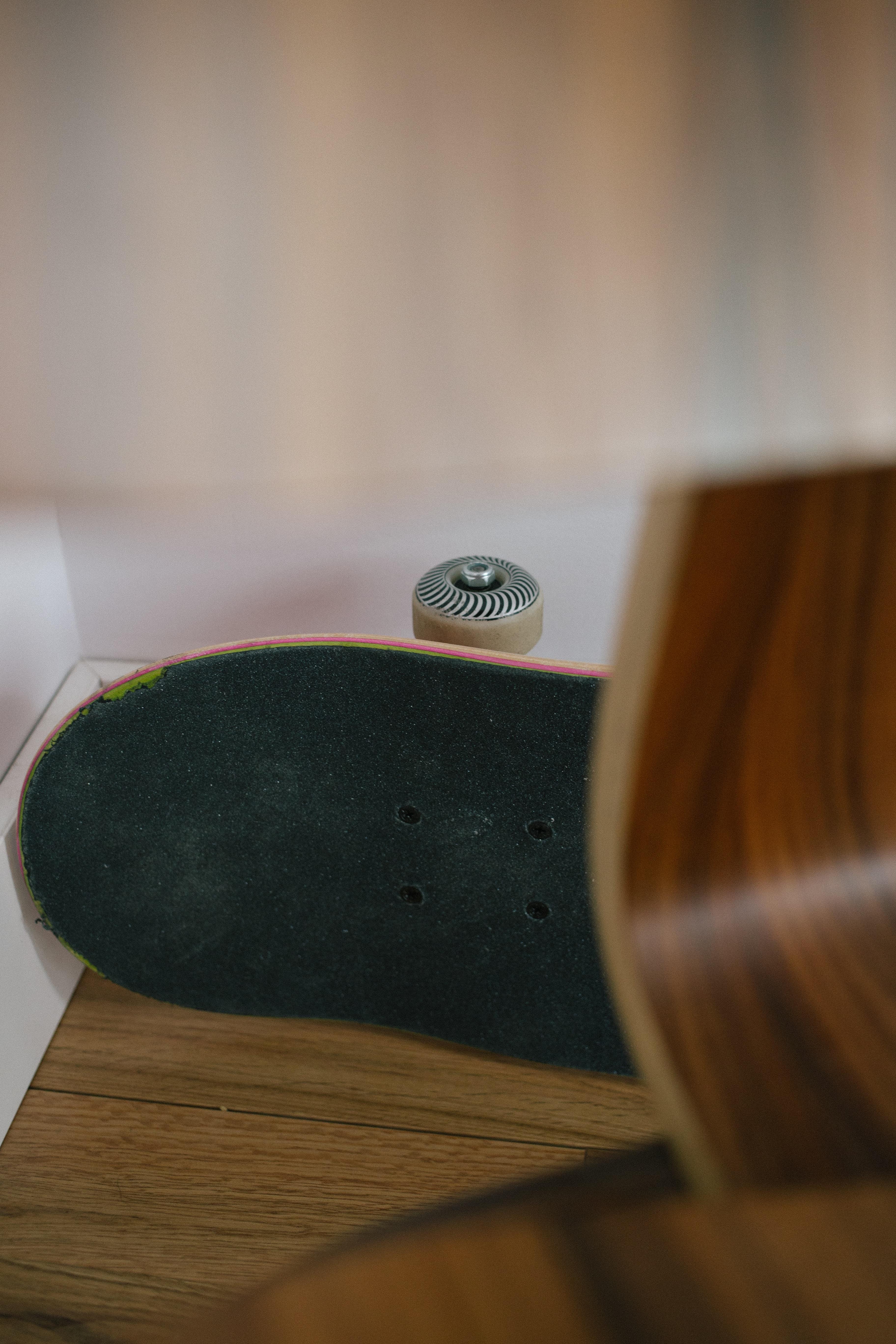 black wooden skateboard on floor