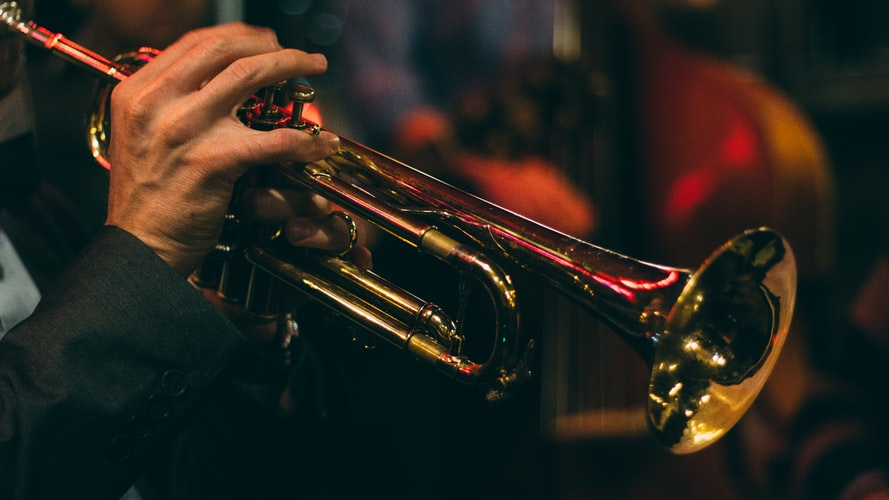 Man plays the trumpet Photo by Chris Bair on Unsplash