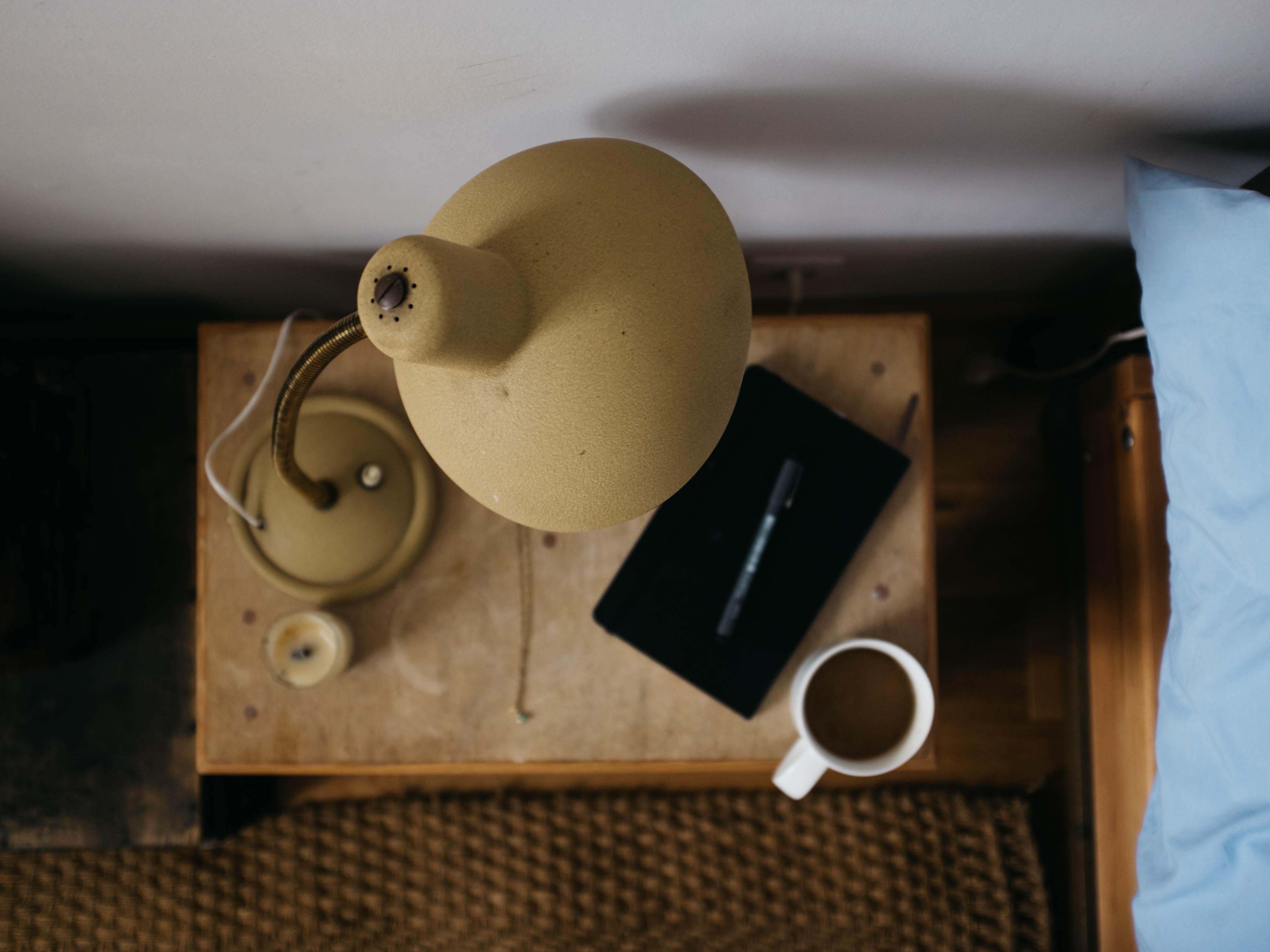 beige gooseneck desk lamp on table