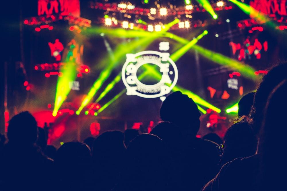 people in dancing in green lights