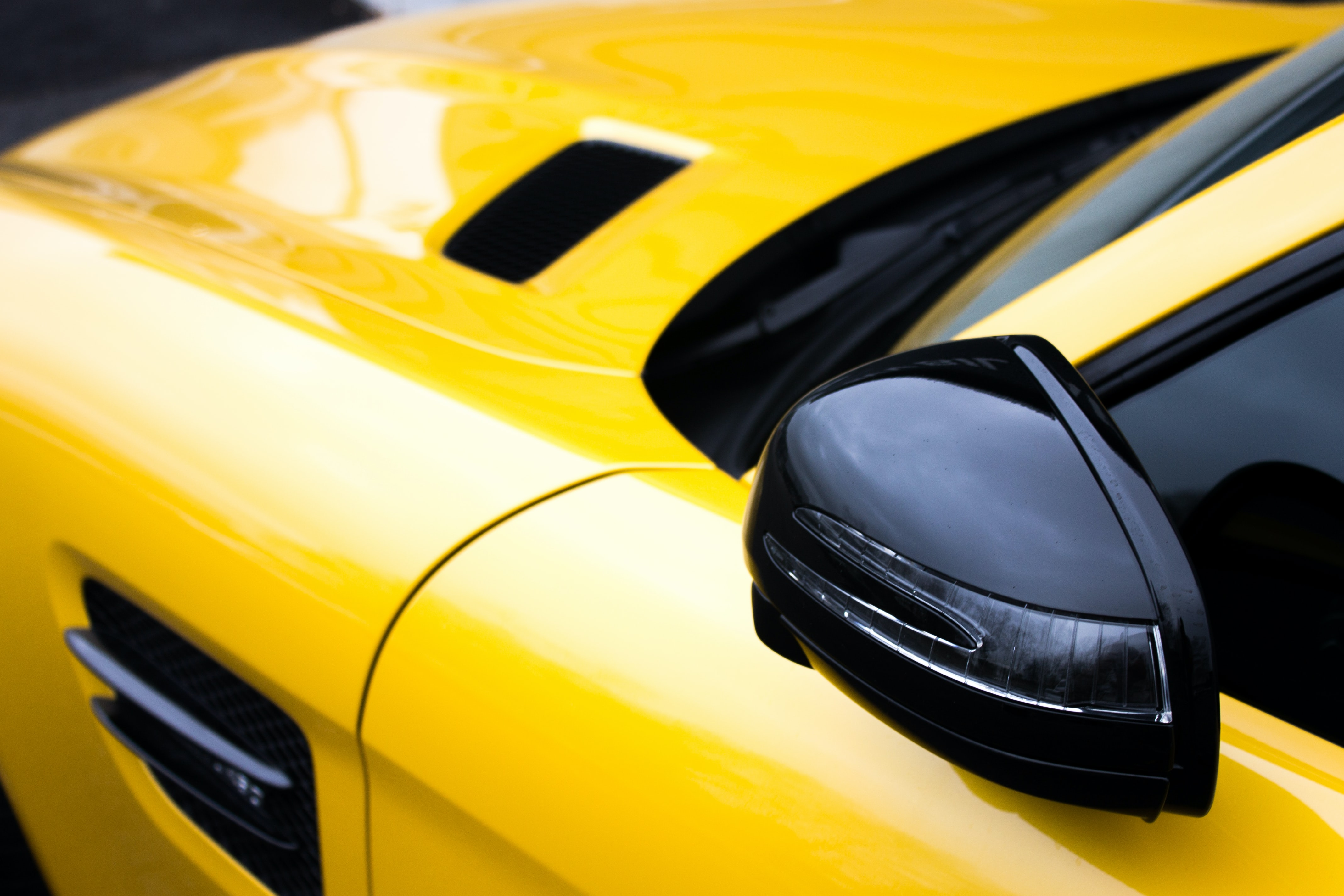 closeup photo of yellow and black car