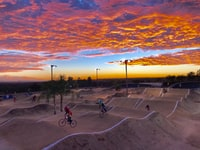 Racing the BMX racetrack at the Arco Olympic Center.