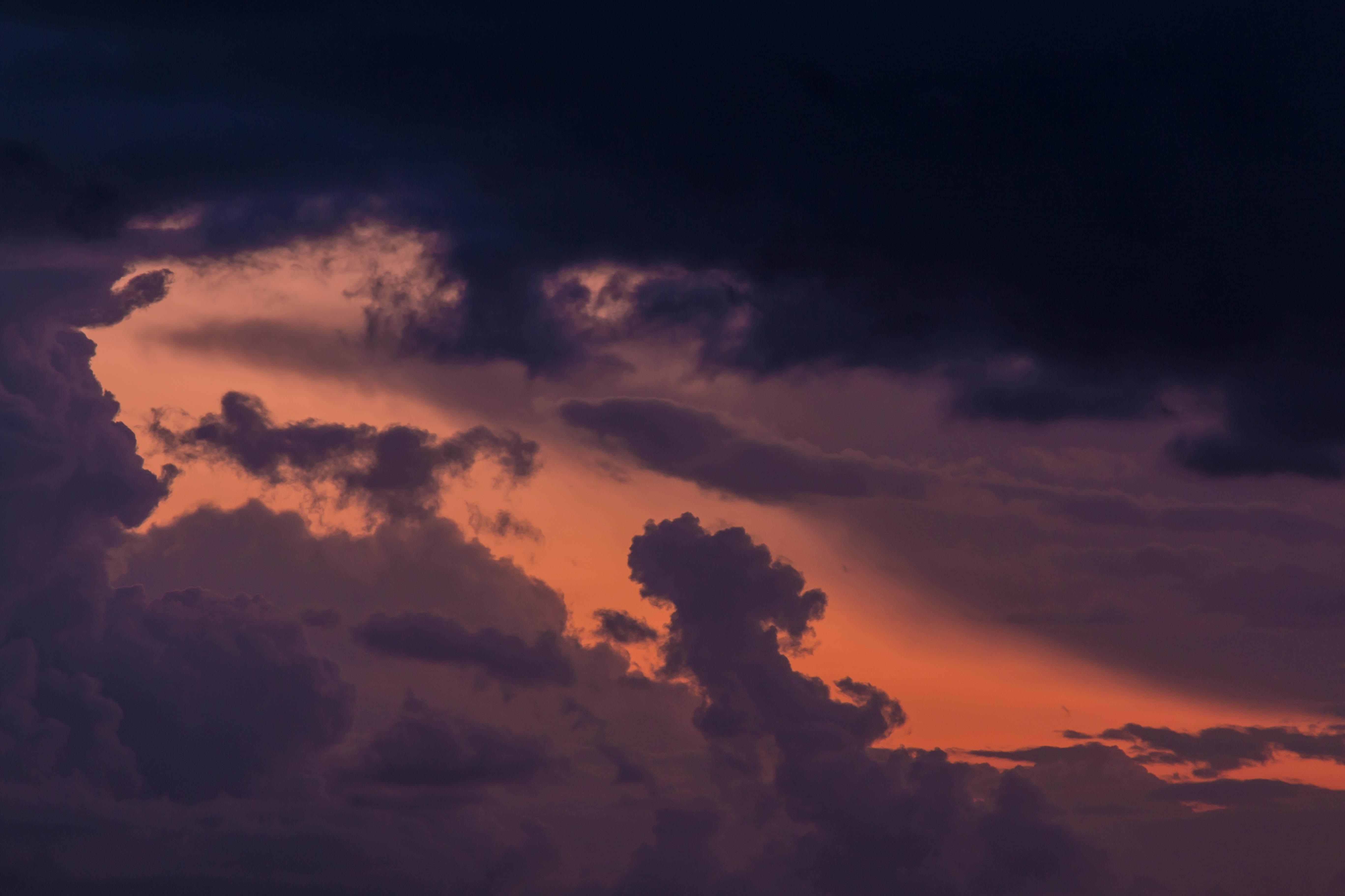 orange sky behind dark clouds