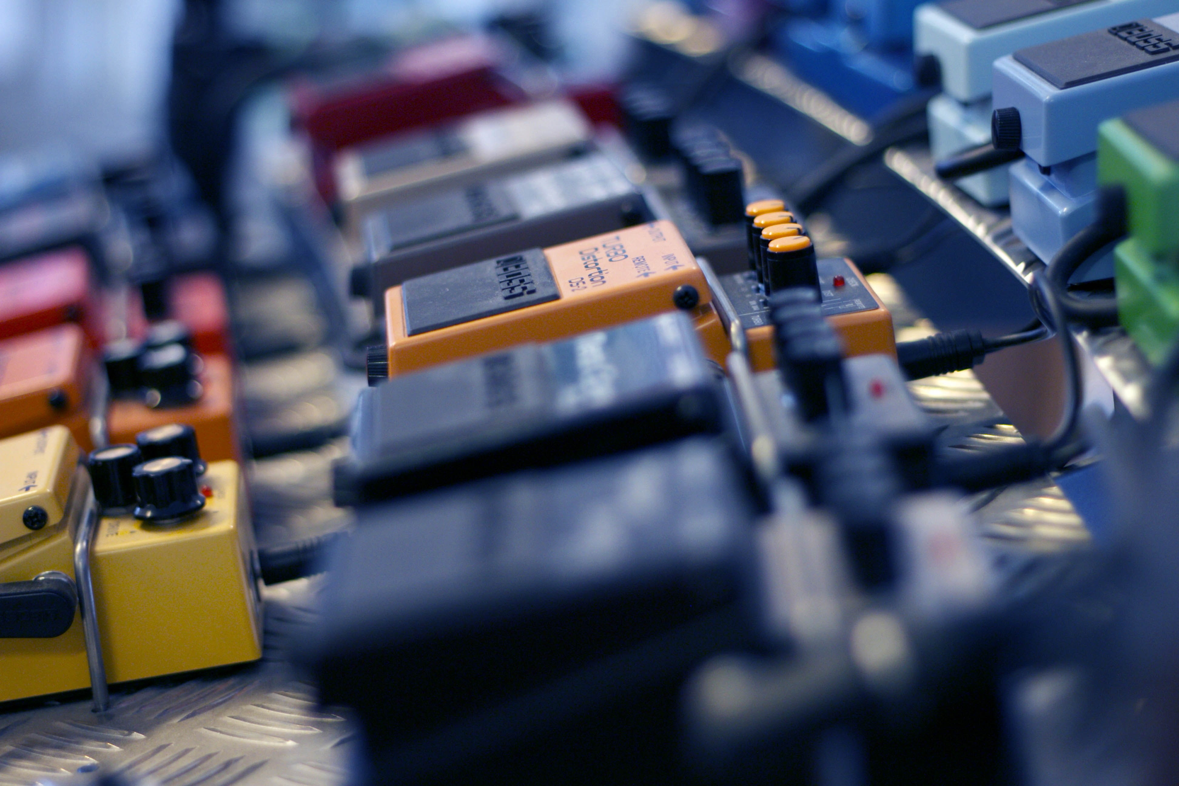 selective focus photo of guitar pedals