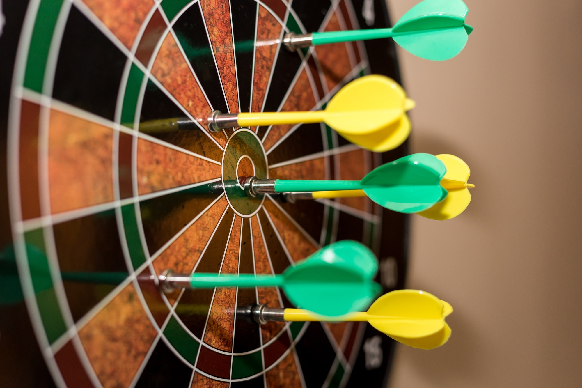 Close up of magnetic darts on dartboard