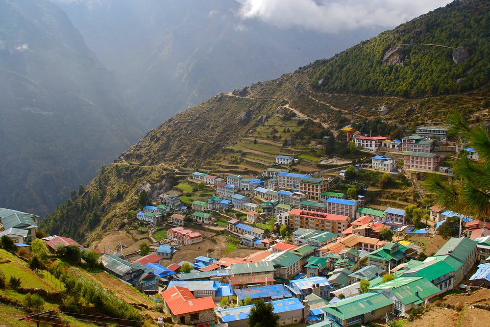 aerial photography of community on mountain