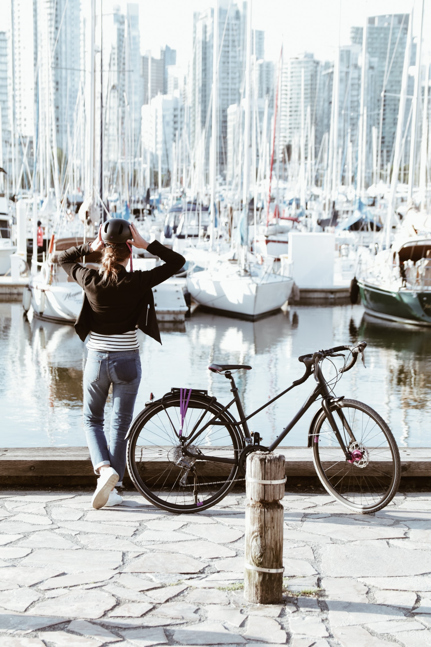person standing beside road bicycle during daytime