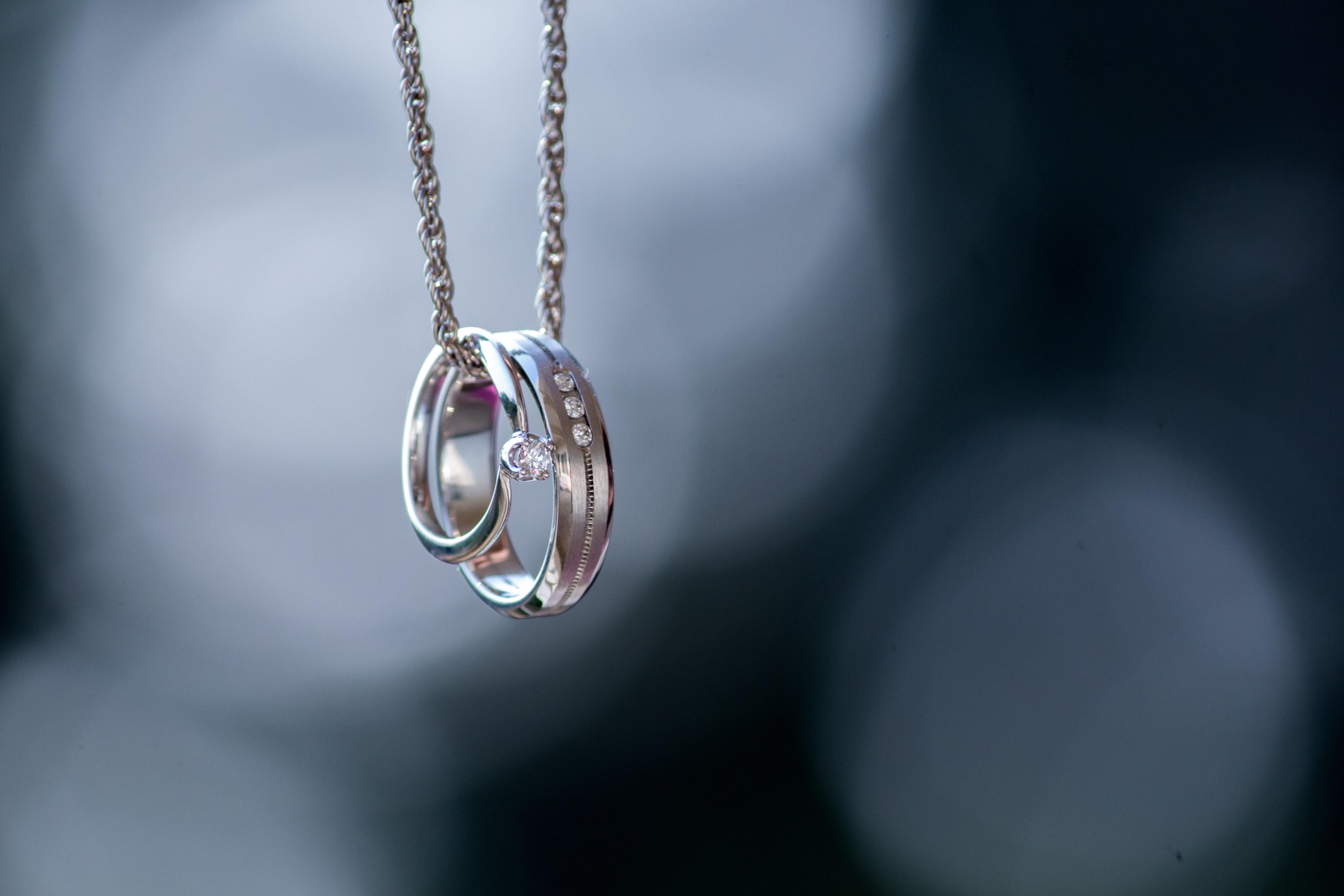 silver-colored ring pendant
