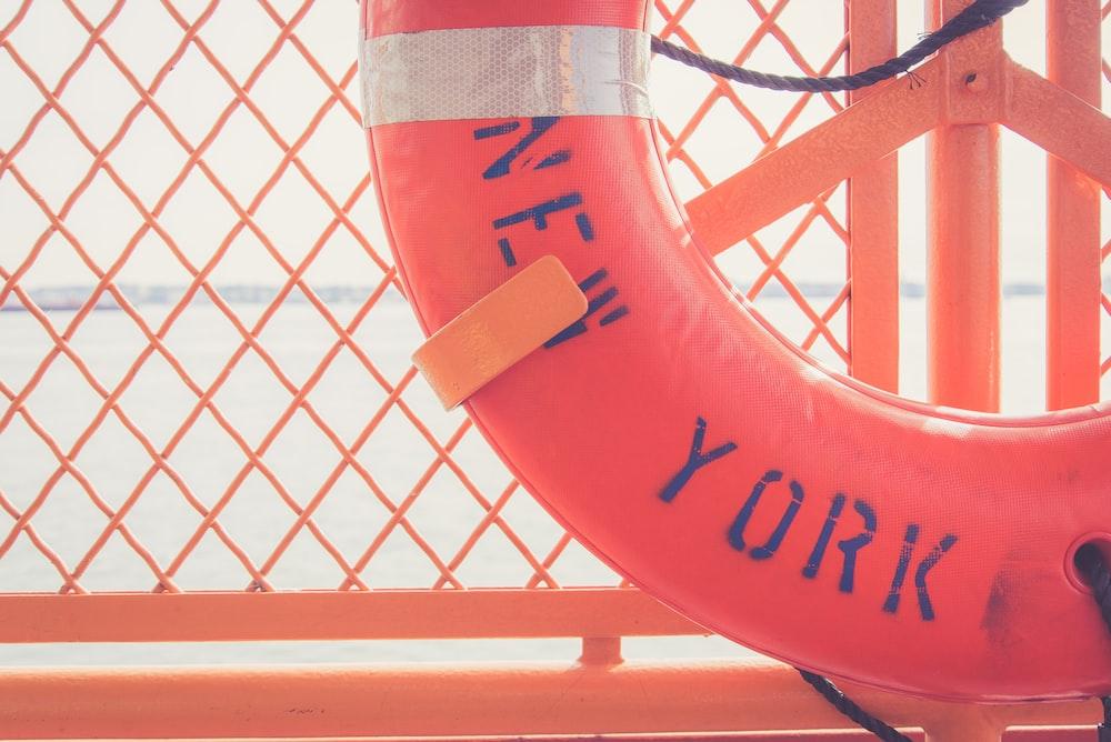 red inflatable floater ring on orange metal rack