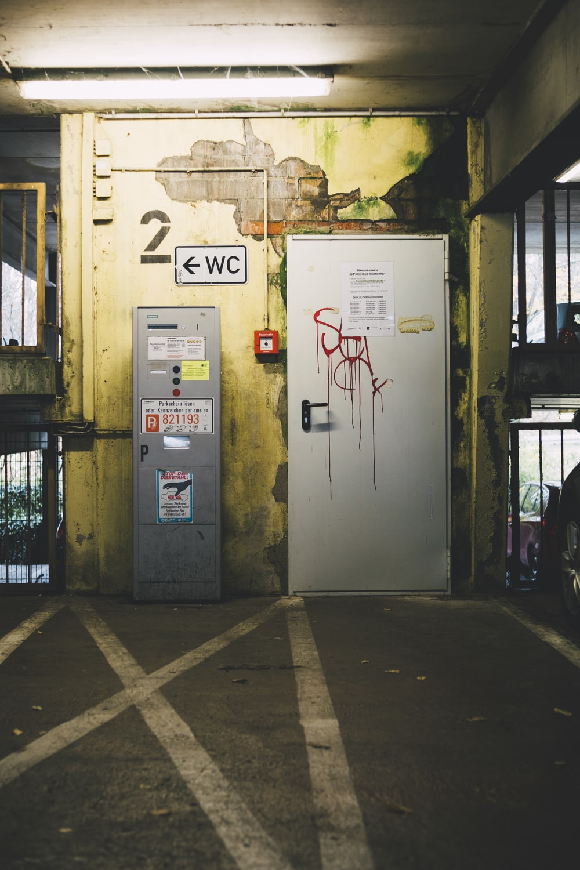 white 1-door cabinet beside gray electricity distortion