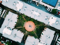 aerial photography of courtyard surrounded by high-rise buildings