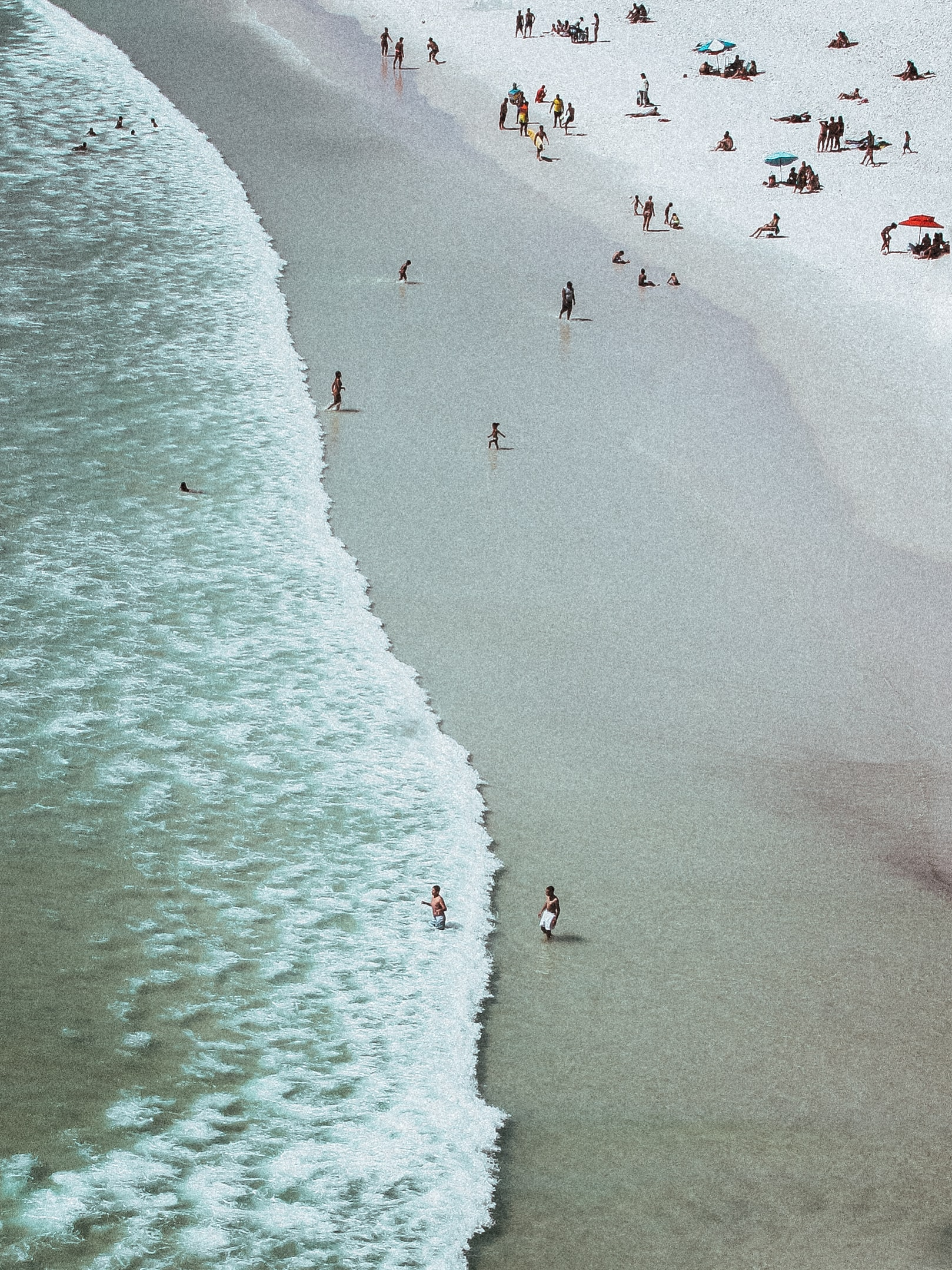 aerial photography of people on white sand beach