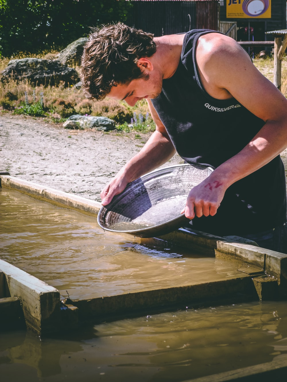 man holding basin