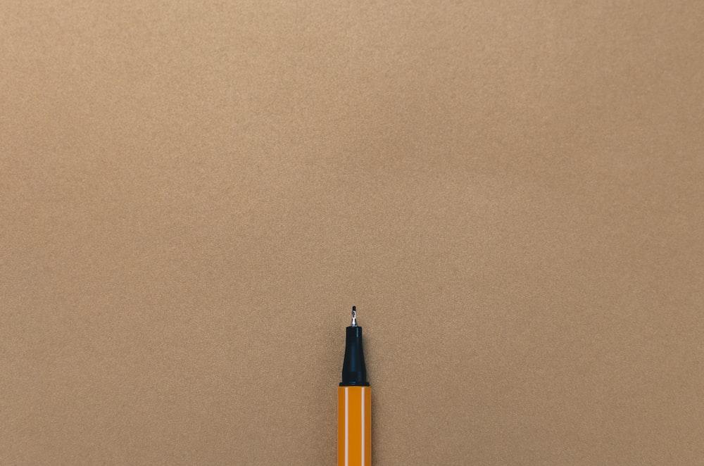 pen on brown board