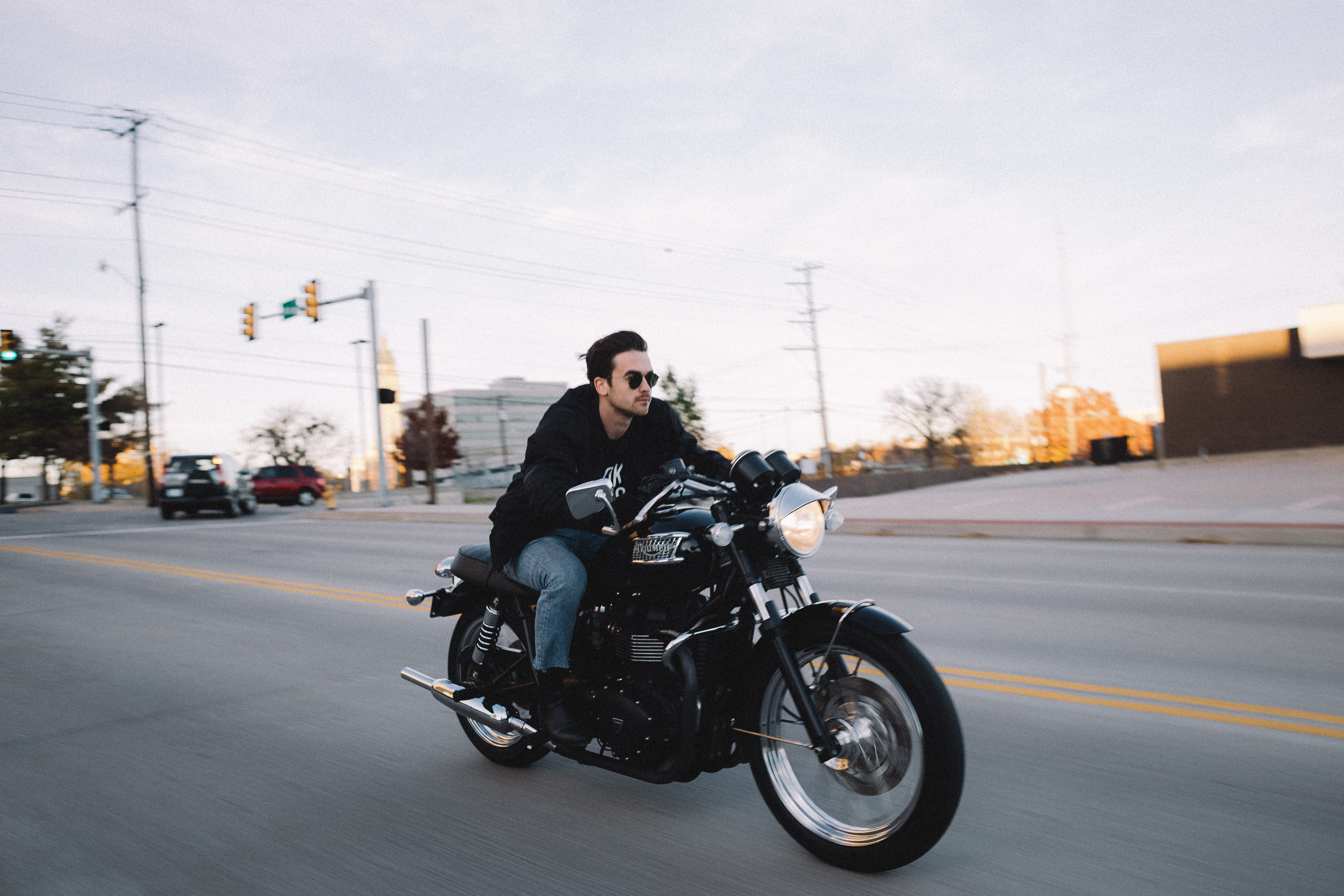 man riding cruiser motorcycle at the road during day