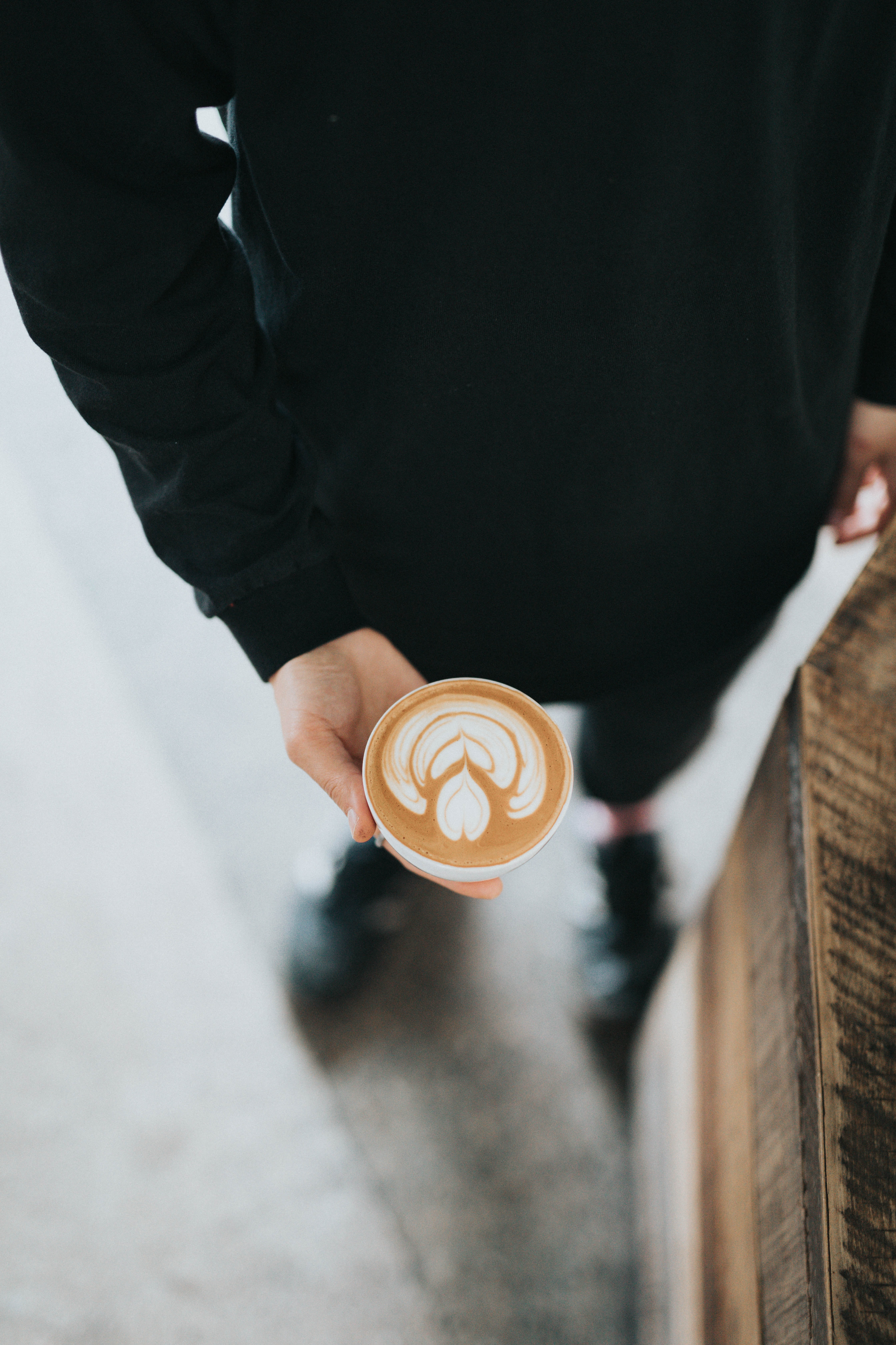 person holding cup filled with coffee