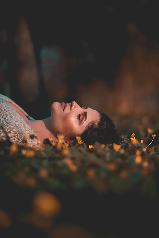 woman lying on grass