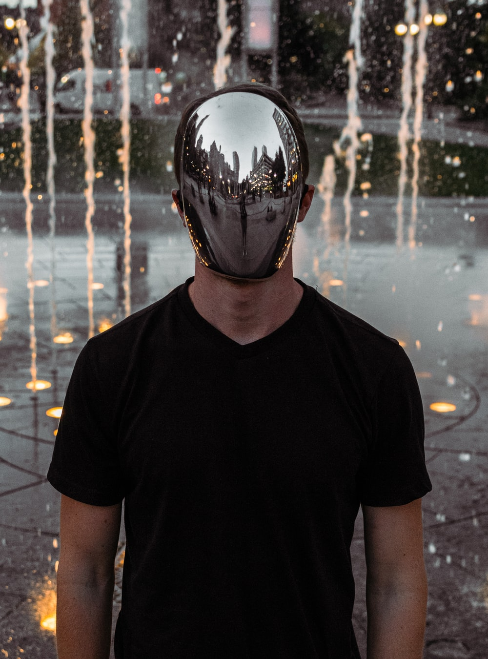 man covering his face standing