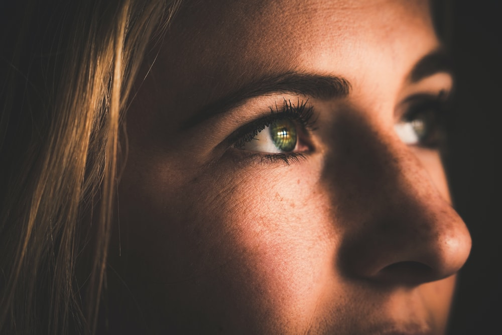 close-up photography of woman's face