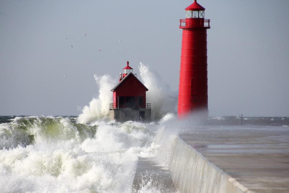 red lighthouse near sea