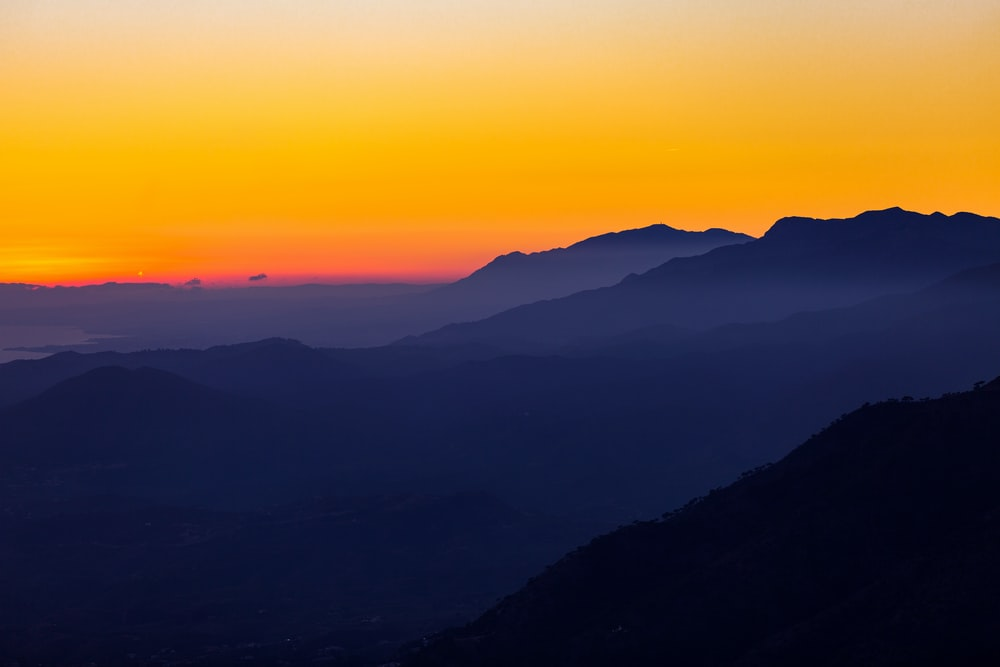 silhouette of mountain with sunset