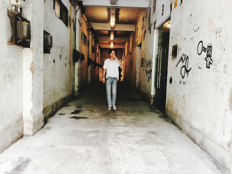 person standing between hallway