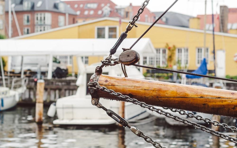 white boat near dock at daytime